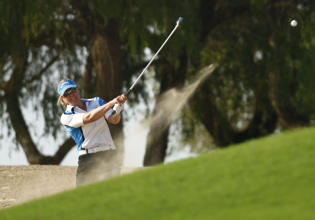 Sweden's Annika Sorenstam, winner of the Dubai Ladies Masters European Tour event, takes her second shot on the 13th hole during the final round