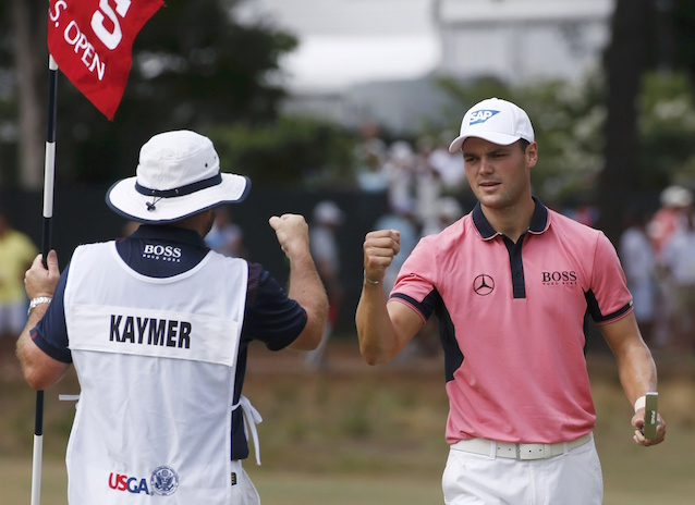 Kaymer of Germany is congratulated by his caddy after sinking an eagle putt on the fifth green during the third round of the U.S. Open Championship in Pinehurst