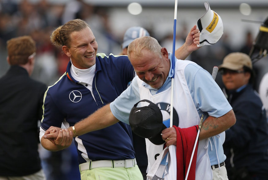 Marcel Siem of Germany poses with the trophy after winning the BMW Masters 2014 golf tournament at Lake Malaren Golf Club in Shanghai